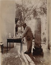 Rodin working under the peristyle of the Pavillon de l'Alma in Meudonc.1912. Photo by Jean Limet
