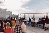 People sit enjoying refreshments in the cafe at Tate St Ives after a Late at Tate event