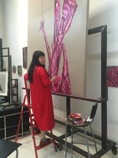Artist Cai Jin working on a painting from her Banana Plant series in the studio
