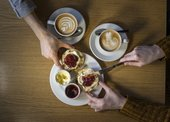 Overhead shot of hands and coffees