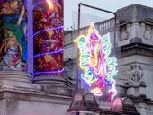 Ganesh in neon on the facade of Tate Britain