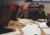 School children drawing their designs