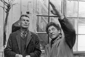 A black and white photograph of Samuel Beckett and Alberto Giacometti in Giacometti's studio