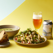 Photo of beer, soup, bread and salad