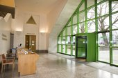 Clore Foyer reception with a green door for entry