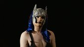 Film still of a woman in a headdress