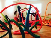 Kids with curly bendy sculptures