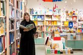 A person stands to look at a book in the Tate St Ives shop