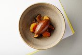 Dish of chocolate mousse, roasted figs, clementine