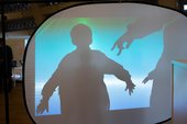Primary school pupil creating shadow performance at London CLC at Tate Exchange