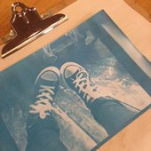 A cyanotype print of a kid's feet