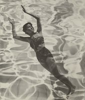 Black and white photograph of a women in a swimsuit with her arms in the air overlaid with the texture of water