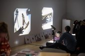 Child playing with a projector