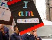 A student holding his 'I Am Marvellous' placard, taken at I Am Tate Exchange Festival 2019