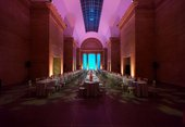 tables set up for dining in the Duveen gallery
