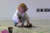photograph of child taking part in the workshop 'Under 5s Explore: The Elements'