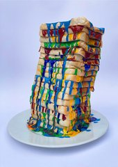 a photo of a stack of bread with paint in between every slice