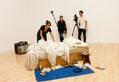 Tracey Emin installing My Bed at Tate Britain