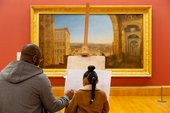 Visitors sketching paintings in the Turner Collection at Tate Britain