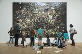 a group of children stand in front of an artwork in Tate Modern gallery