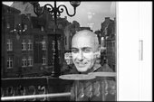 black and white photograph of Farooq Chaudhry through a window