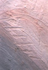 Fig.11 Detail of sgraffito work in paint depicting a finger nail