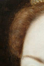 Fig.13 Detail of the sitter's right brow, hair and background, showing sgraffito work in the dark backgound paint to describe tendrils of hair