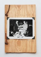 Fig.14 Photograph of the front cover of Business Cards, and artists book by Ed Ruscha and Billy Al Bengston; bound in faux woodgrain paper with a black-and-white photograph of two men in suits shaking hands and looking at the camera