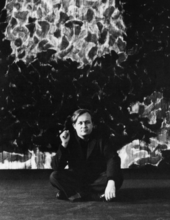 Fig.14 Sam Francis in front of the second state of Deep Orange and Black 1953–5 at his exhibition at Galerie Rive Droite, Paris, 1955