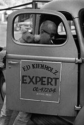 Fig.15 Black-and-white photograph of Edward Kienholz getting into hi pick-up truck, on the door of which is printed: Ed Kienholz, EXPERT