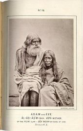A portrait of two people wrapped in cloth, one with long hair and the other with a beard.