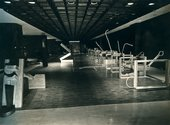 Black-and-white photograph of a large exhibition hall, with Roberto Chabet's Hurdling 1970, a series of vertically suspended frames (a reference to athletic hurdles) from which stem jagged protrusions made of found scraps of metal