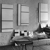Anthony Hill's studio in Greek Street, London, 1956, showing paintings in progress