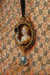 Fig.22 Detail of the patterning of the dress and the cameo brooch