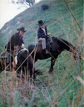 Fig.2 Photograph of Joe Goode and Ed Ruscha wearing cowboy hats on horseback on a green hillside