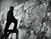 Fig.37 Sam Francis on a ladder in front of one of the Basel Mural canvases in his Arcueil studio, Paris, c.1958