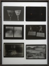A photographic multiple comprising six large photographic negatives, arranged in two columns of three, suspended between glass plates in an iron frame.