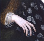 Fig.5 Detail of the sitter's right hand, showing the brownish grey priming at the end of the little finger