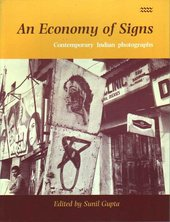 The front cover of a book featuring a photograph of street signs and posters.