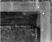 Fig.6 X-radiograph of the top right corner of the painting before removal of the extensions. Note the old damage to the edges of the original canvas and the cusping in its right edge