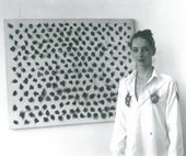 Fig.6 A model wearing Henk Peeters's pyrography shirt while standing next to 60–13 1960, Galerie Coumans, Utrecht, 1987