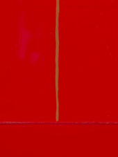 A detail of the deep red surface of Red Barn Door, showing an olive-green line running vertically from the top centre, which meets a ridge of red paint running horizontally below it.