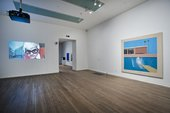 Fig 3 Installation view of David Hockney's A Bigger Splash 1967 (right) with Jack Hazan's film, A Bigger Splash 1973 (left) in the exhibition A Bigger Splash 2012