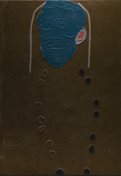 A photograph of The Generals showing the deep outlines of the buttons, the ear, and the soft ridges in the blue paint that describe the facial features.