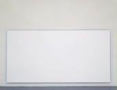A photograph of a large white canvas hanging just off the floor in a gallery space.