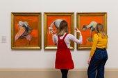 Visitors at Tate Britain looking at a Francis Bacon painting