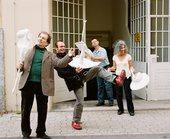 Franz West, Reinhard Bernsteiner, Herbert Flois and Songül Boyraz posing with Passstücke outside the artist's studio in Vienna, 2007, photographed by Lukas Schaller