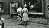 Two ladies looking at a painting in Gallery 1950, Tate Britain