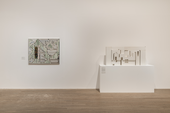 Geometric painting and sculpture in gallery