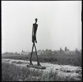 Giacometti's Walking Man I, 1960 photographed by Ernst Scheidegger in the Swiss countryside, 1963